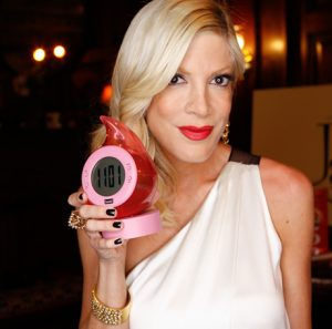 tori-spelling-with-her-hot-new-pink-colored-bedol-water-clock